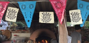 The pizza oven outdoor kitchen, complete with linoleum block print decorations and calabaza artist Shannon Holman.