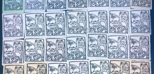 Linoleum block prints on handmade paper