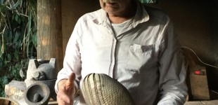Per Anderson, the director, admiring an armadillo shell